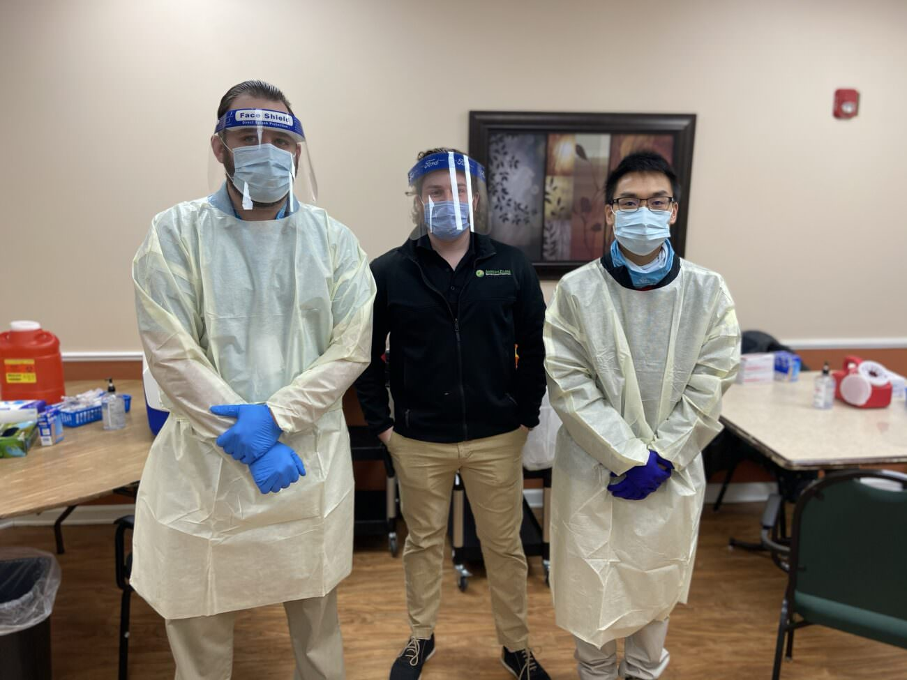 Kevin Christiano, Ashton Place Administrator, stands with two medical workers who administered the Pfizer BioNTech COVID-19 vaccine on Monday, January 11th, 2021
