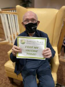 """An Ashton Place resident holds a sign saying """"I got my vaccine today!"""""""