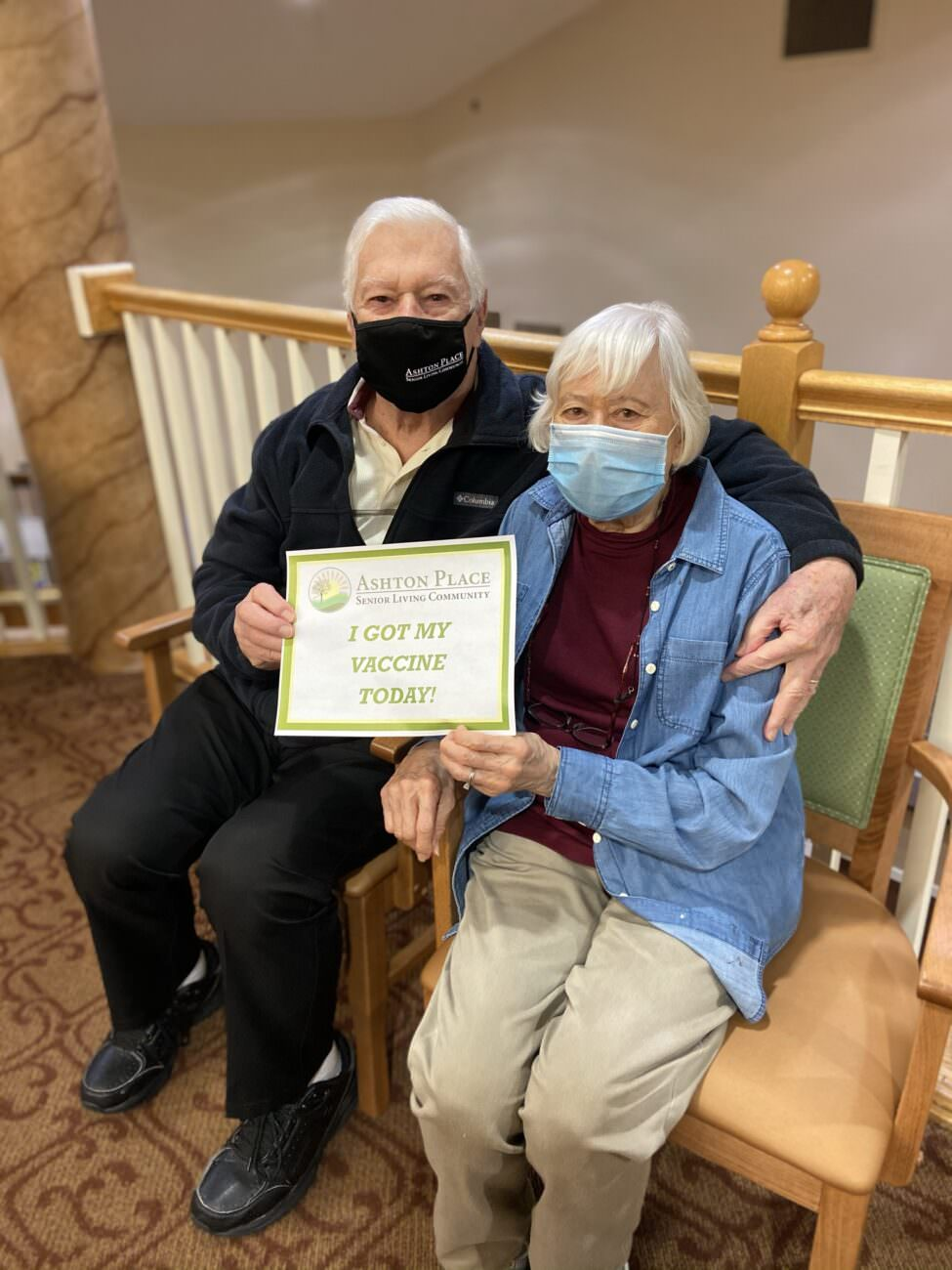 """Two Ashton Place residents hold a sign saying """"I got my vaccine today!"""""""