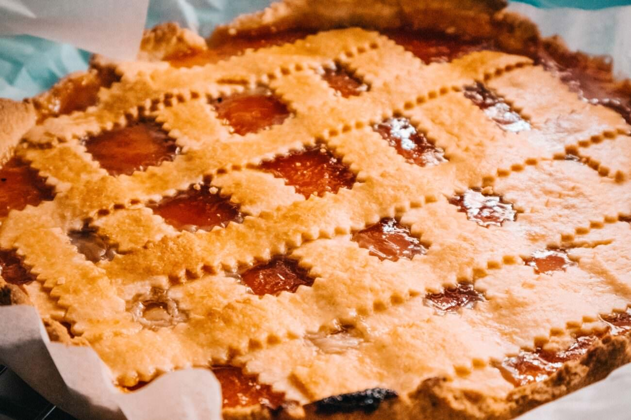 close up of a holiday pie with a decorative crust